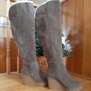Tall wedge boots. New condition.